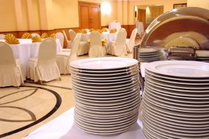 Dinner plates stacked for a buffet