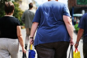 Rear shot of an obese woman with shopping bags