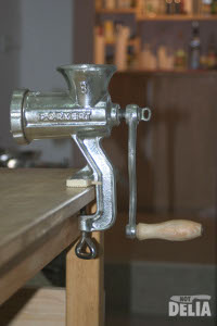 The Porkert No.8 Mincer assembled and clamped to a work table