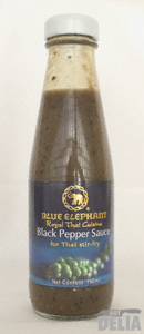 A bottle of Blue Elephant black pepper sauce