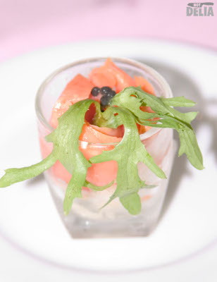 Smoked salmon with caviare and wild rocket in a shot glass