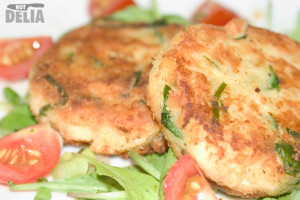 Salmon fishcakes with spinach on a bed of rocket leaves with cherry tomatoes