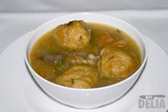 Bowl of brown Windsor soup with dumplings
