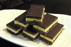 Nanaimo bars - three-layered bars flavoured with chocolate, nuts and vanilla