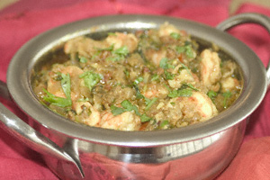 Prawn pathia in a steel presentation karahi