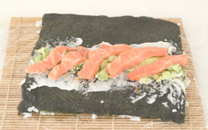 Nori sheet on a makisu and spread with a little wasabi and a more generous spread of mayonnaise