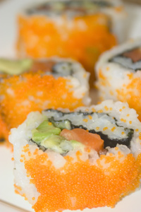 California rolls (uramakizushi) with bright red fish roe on the outside