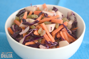 Chunky salad with red cabbage, carrot, apple and sultanas in a bowl