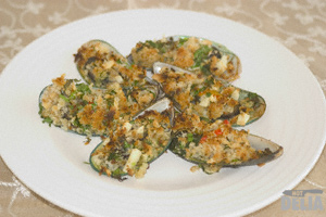 Crumbed mussels on a plate