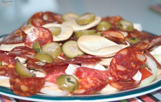 Gozitan snacks - olives, salami, cheese - arranged on a plate
