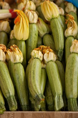 Courgettes with their flowers still attached