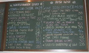 Blackboard with a food menu written in coloured chalks