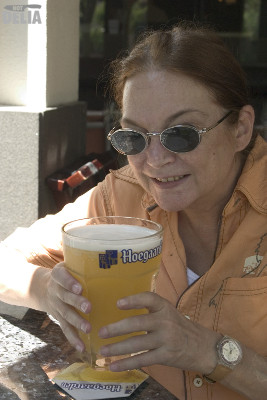 Not Delia struggles to hold a large glass of Hoegaarden