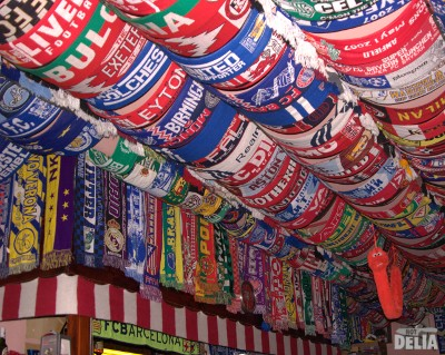 Football scarves on a bar ceiling