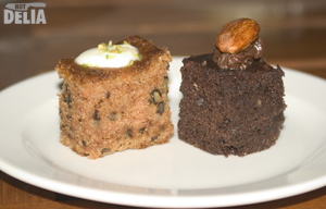 A brownie and a piece of carrot cake