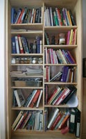 Bookcase with several dozen cookbooks
