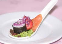 Smoked salmon and maki roll presented on a Chinese soup spoon