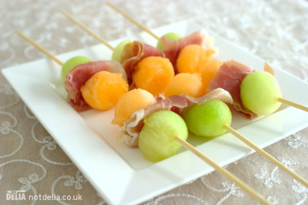 Parma ham with melon balls on skewers