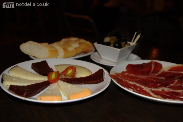 A selection of Manchego cheese, Tapa Negra ham, bread and olives from the Tapas Cafe in Bangkok
