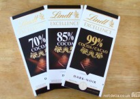Three bars of Lindt Excellence chocolate: 70%, 85% and 99%